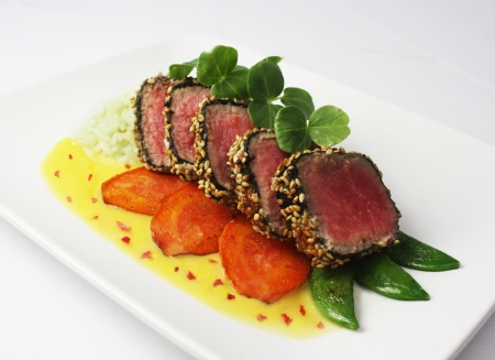 Sesame Crusted Seared Rare Ahi, Wasabi Rice, Hibiscus-Orange Buerre Blanc, Sauteed Veggies